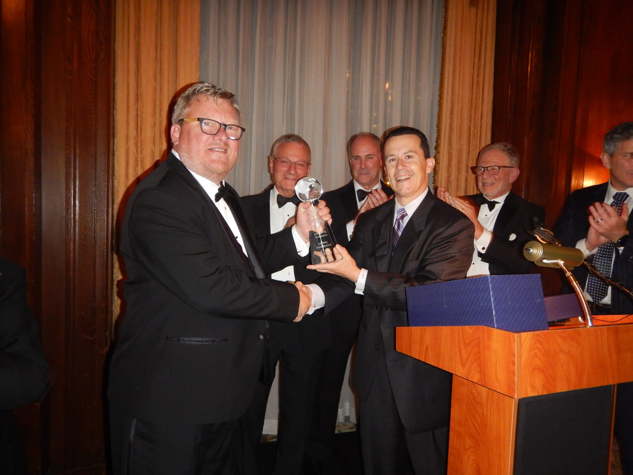 EVP Jim Rodriguez presents President Jim Waldon with his award Photo by Robert L. Feldman